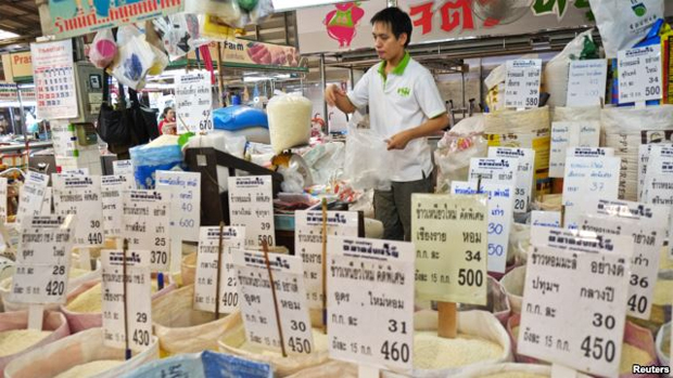 THAILAND'S CONTROVERSIAL RICE POLICY HELPS NEIGHBORS' EXPORTS